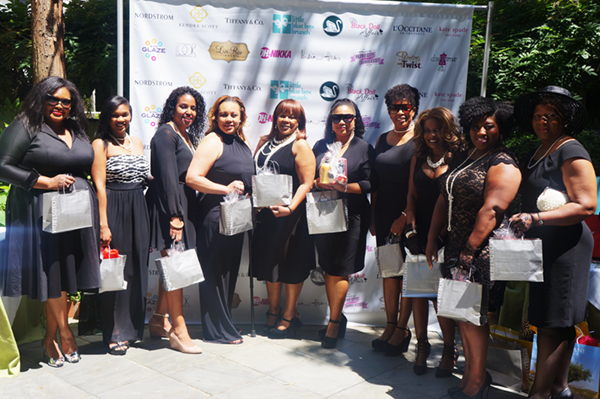The ladies show off bags filled with Nordstrom beauty essentials